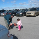 Julia and Warren play football in the Parking Lot
