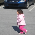 Julia plays in the parking lot