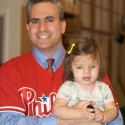 Not missing a chance to wear his Phillies jersey over a suit, Daddy gets ready to go to work!