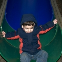 Michael carefully gets off the slide