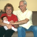 Bubbie, Grandpa and Sara together on the sofa