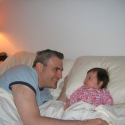Sara and Daddy laze in bed...