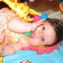 Playing on her playmat