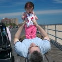 Sara and Daddy playing on the boardwalk in Coney Island