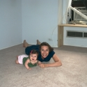 Before leaving, Sara and Mommy play on the new carpet in our bedroom!