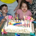 Julia and Joshua helped blow out the candles