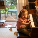 At Aunt Gorgeous's house, Sara tickles the ivories