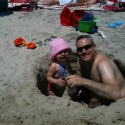 Daddy and Sara dig a giant hole in the beach